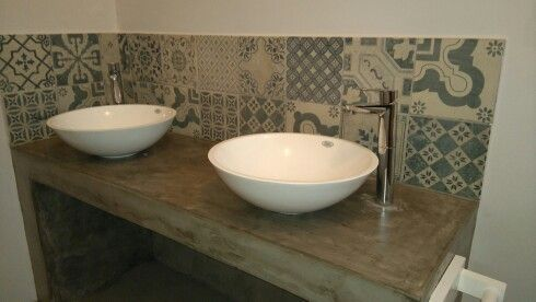 Unmatched tiles as a splashback and cement screeded tops.