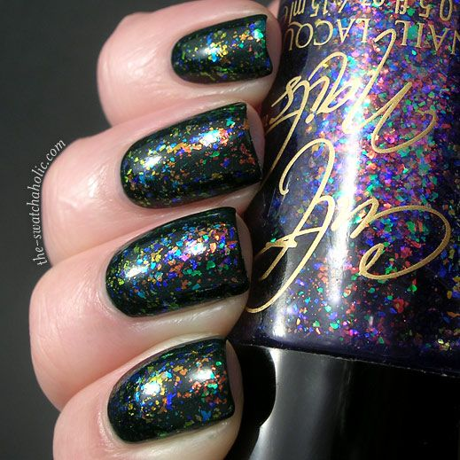 Clairvoyant by Cult Nails over black.  I love the mica-flake glitter look.  Would be fabulous with a matte finish.