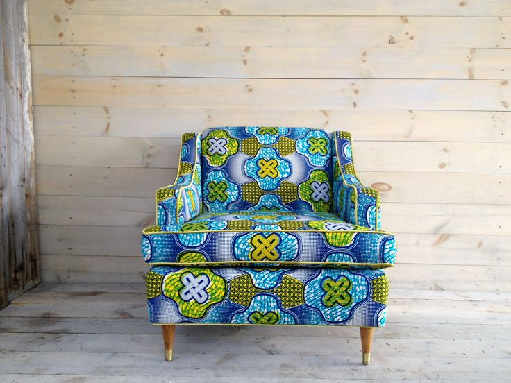 lub chair daringly reupholstered in a vibrant turquoise and lemon African wax print