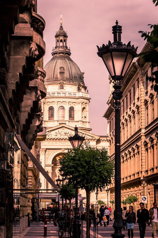 """""""Walking around Budapest"""" by Mark Kats. Budapest is the largest city of Hungary. It is the country's principal political, commercial, cultural, industrial and transportation centre. It occupies both banks of the river Danube."""