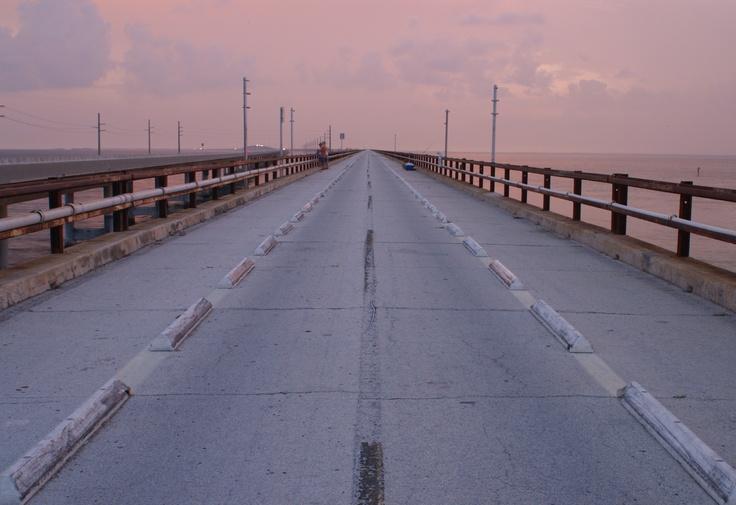 The old seven-mile bridge south of Marathon on the Florida Keys. The new causeway runs parallel.