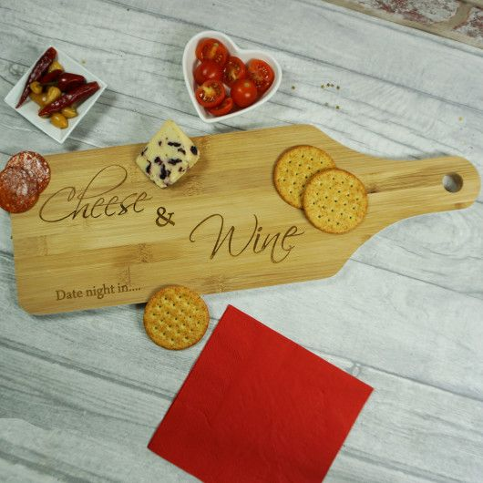 Cheese & Wine Bamboo Paddle Board.  This Cheese & Wine Bamboo Paddle Board is the perfect gift for anyone who enjoys entertaining, it's great for tapas style dining.    You can personalise this board to make it one of a kind. Changing 'Cheese' & 'Wine' to anything you like as well as changing the message in the bottom left corner.  This gift is perfect for birthdays, anniversaries or just because!