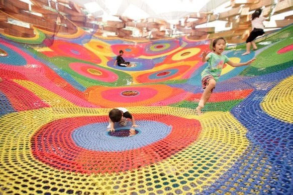The Knitted Wonder Space II, which opened at Hakone Open Air Museum in Japan in 2009. A tunnels of holes capture the sensation of bobbing through water while dipping across the flat swaths of knitting must feel akin to moon-walking.