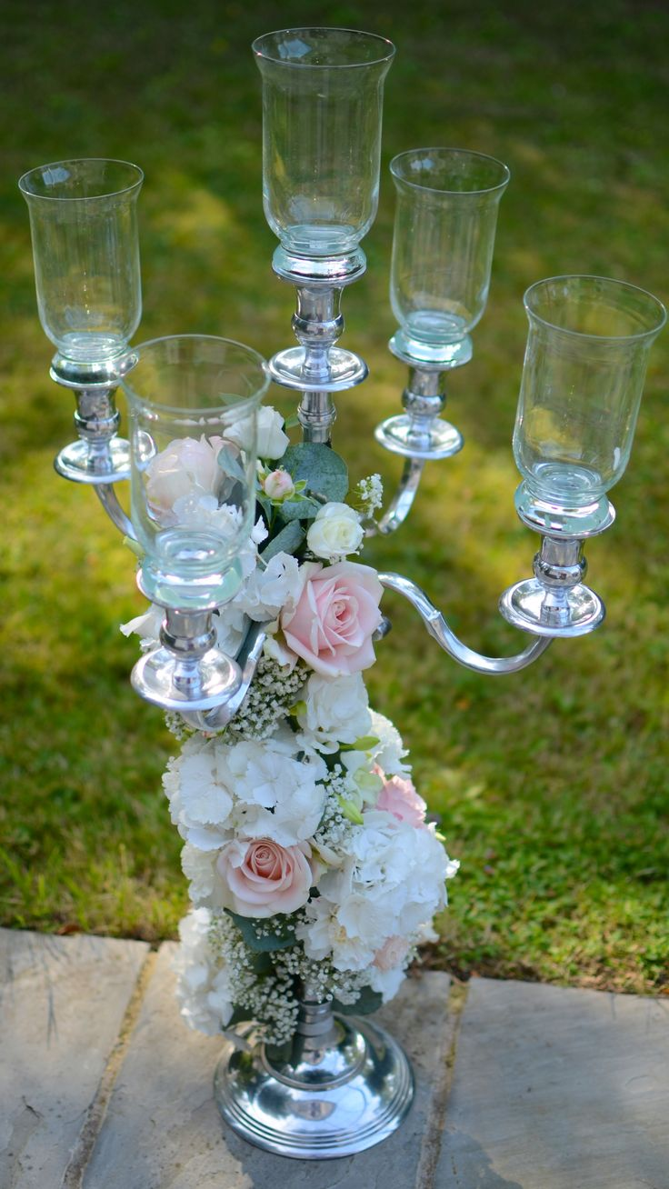 Silver candelabra with trailing flowers in pink and white