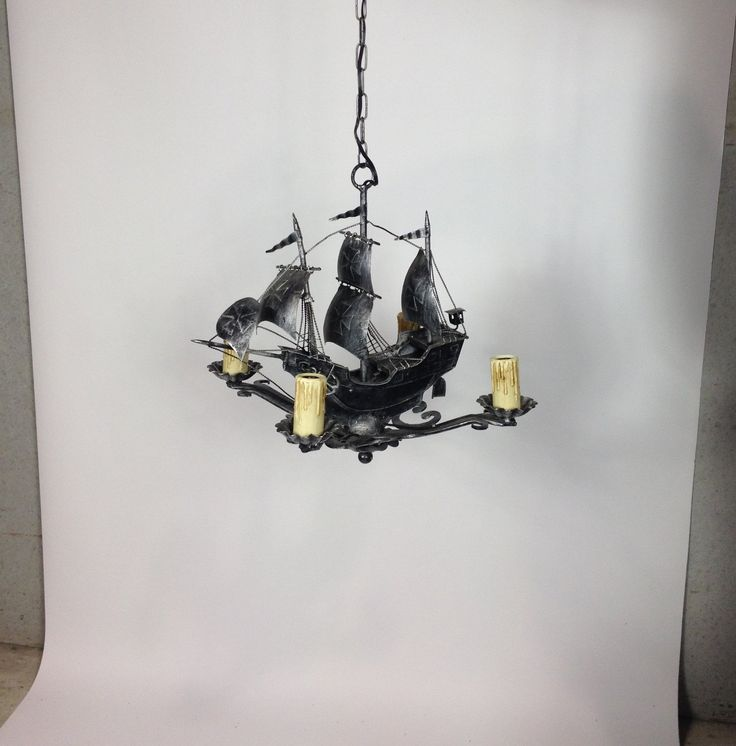 """Ahoy!  Intricately detailed Spanish-revival galleon chandelier to sail over the dining room table. Or perhaps if it's not everyone's flask of rum, you can certainly see this kitsch early 20th century piece swinging from the rafters above the snooker table in some bearded fellow's man-cave. Four plastic """"candle"""" lightbulb holders are intact (if delicate).     Spanish Revival originated in California and Florida in the early twentieth century and was an art deco update of colonial Spanish…"""
