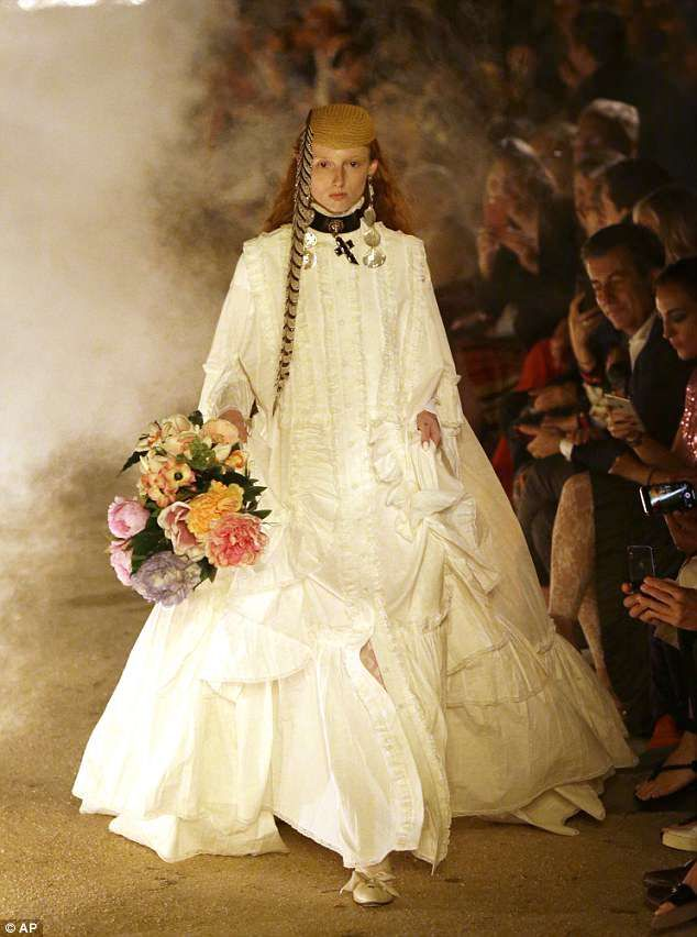 01e48bc96 The Gucci bride: A gothic and eery theme saw a bridal-style gown walked  down the runway
