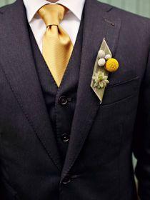 groom's dark grey three piece suit