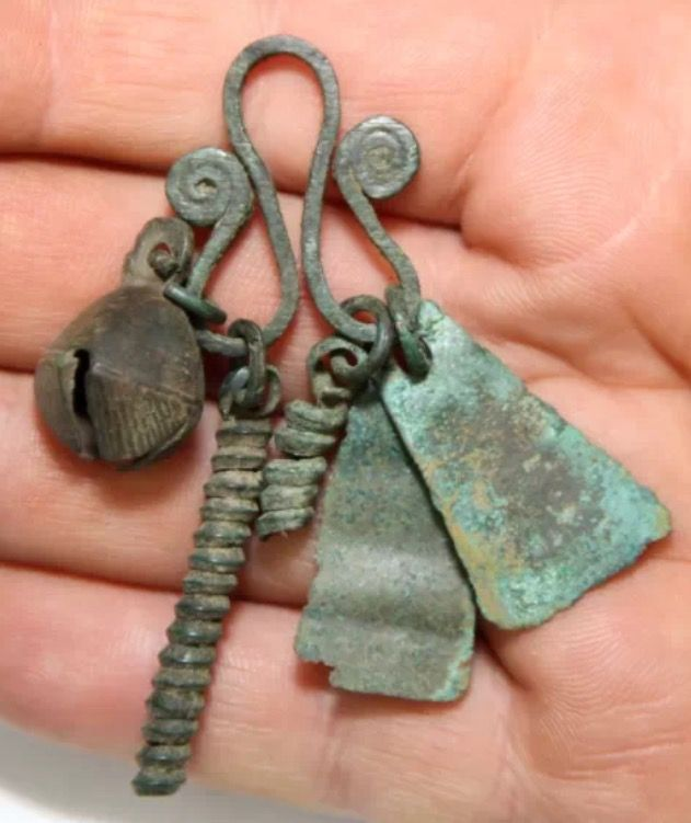 Ancient Viking bronze amulet cluster.