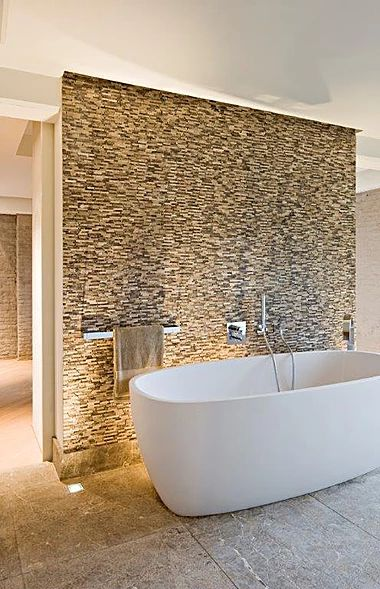 Mosaics made to our own designs in natural stone - vast selection to choose from.