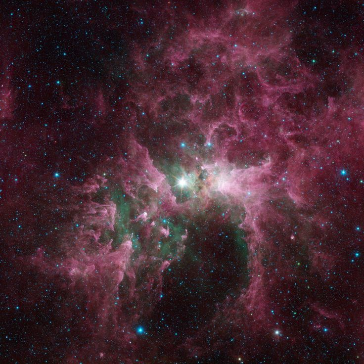 This new view shows the Carina nebula as seen in a new image made by NASA's Spitzer Space Telescope. At the center of the nebula lies Eta Carinae, one of the most massive stars in the galaxy. Its blinding glare sculpts and destroys the surrounding nebula. Eta Carinae represents a true giant of a star. It contains 100 times the mass of our sun, and burns its nuclear fuel so quickly that it blazes at least one million times brighter than the sun.