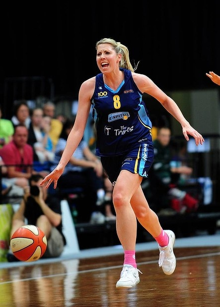 Canberra Capitals player Carly Wilson shouts orders to her teammates during her 250th WNBL match. Canberra defeated Bulleen 75-74 with star player Lauren Jackson watching from the sidelines.