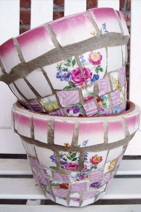 Use tile adhesive to affix pieces of a shattered china plates to a basic terracotta flower pot for a one-of-a-kind piece. The colorful pattern will complement your blooms.