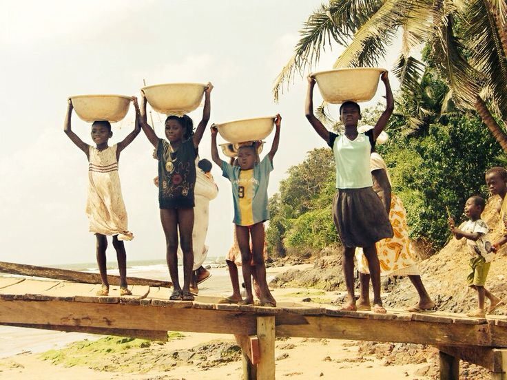 Carrying water after walking about 3 km, Ghana