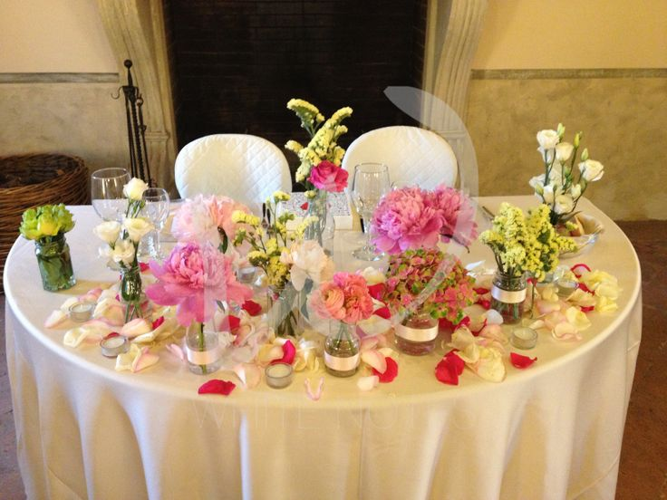 recicled vases and glasses for an eco chic wedding