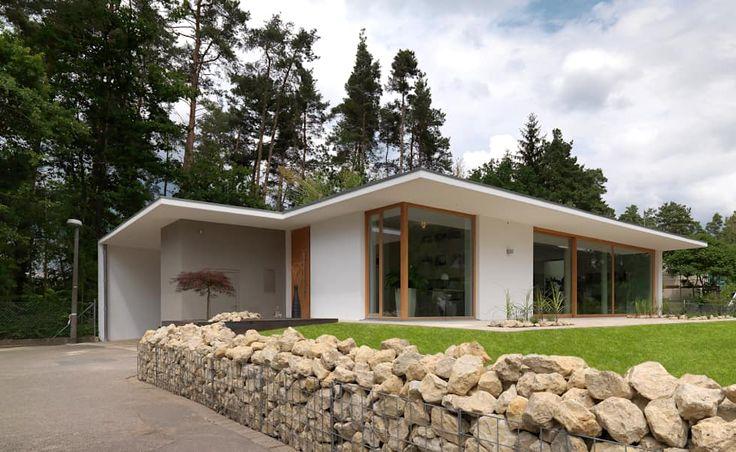 Casas de estilo minimalista por Bermüller + Hauner Architekturwerkstatt