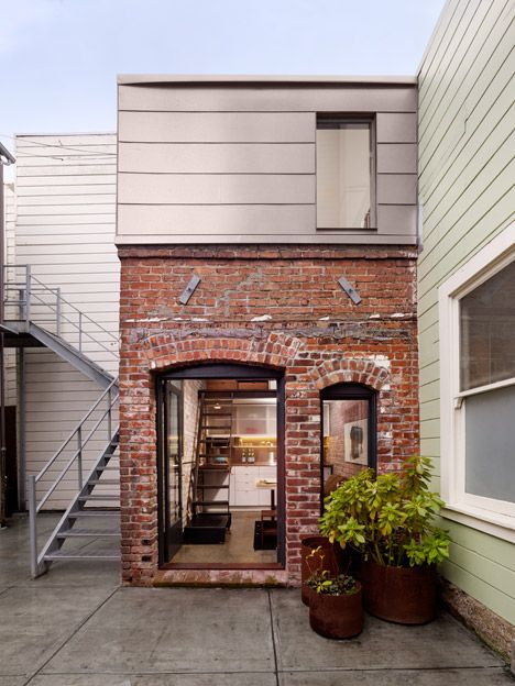 Red-brick boiler room converted into tiny guesthouse by Azevedo Design.