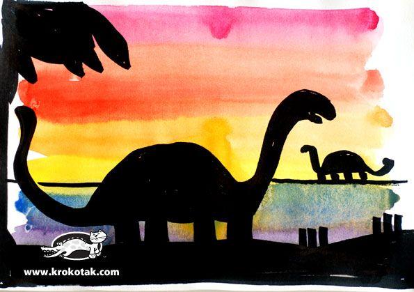 dino's knipên uit zwart papier en een prachtige achtergrond schilderen