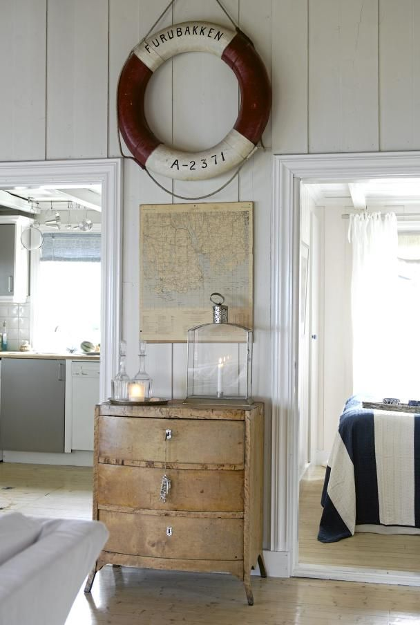 Swedish country style done right. Love the nautical reference, the texture of the old drawers and the bold stripe!