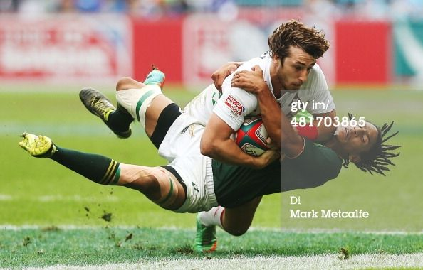 HONG KONG - MARCH 30: Dan Bibby of England is tackled by Justin Geduld of South Africa during the Cup quarter-final match between England and South Africa on day three of the 2014 Hong Kong Sevens at Hong Kong International Stadium on March 30, 2014 in Hong Kong, Hong Kong. (Photo by Mark Metcalfe/Getty Images)