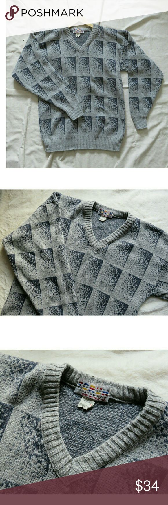 """Men's Vintage Italy Wool Sweater Gray Grid Med Awesome vintage sweater made in Italy from Forum Sportswear! All over grid/ geometric pattern in gray and white. V-neck, wide cuffs at sleeves. 60% wool, 20% acrylic, 15% polyester, 5% other yarns. Unisex, Size Men's Medium, Ladies oversized Medium/ Large. Measures lying flat approximately 21"""" across chest, 29"""" from shoulder to waist, and 27"""" from shoulder down sleeve to wrist. Excellent condition, like new! Packed carefully and shipped fast…"""