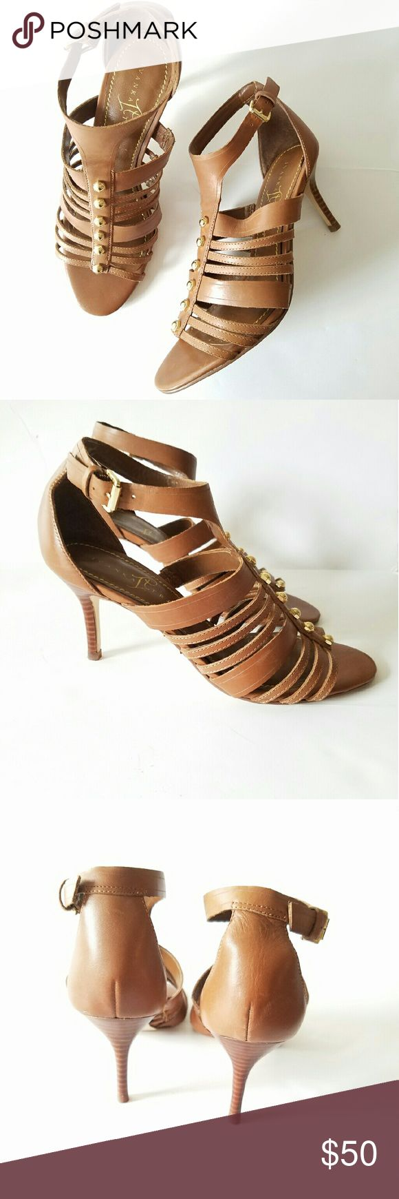 Camel Gladiator Cage Ivanka Leather Heels Sz 7.5 *Great used condition *Camel Colored Leather *Amazing Gladiator Cage Heel Sandals *Gold Hardware Faucets *Ivanka Trump *Size 7.5 *Heels Height 4inch   **Condition score 7 of 10   -* Minor signs of wear when closely inspected. Ivanka Trump Shoes Heels