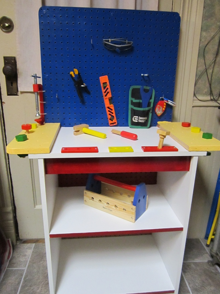 Transformed a cheap tv stand to a great kids workbench
