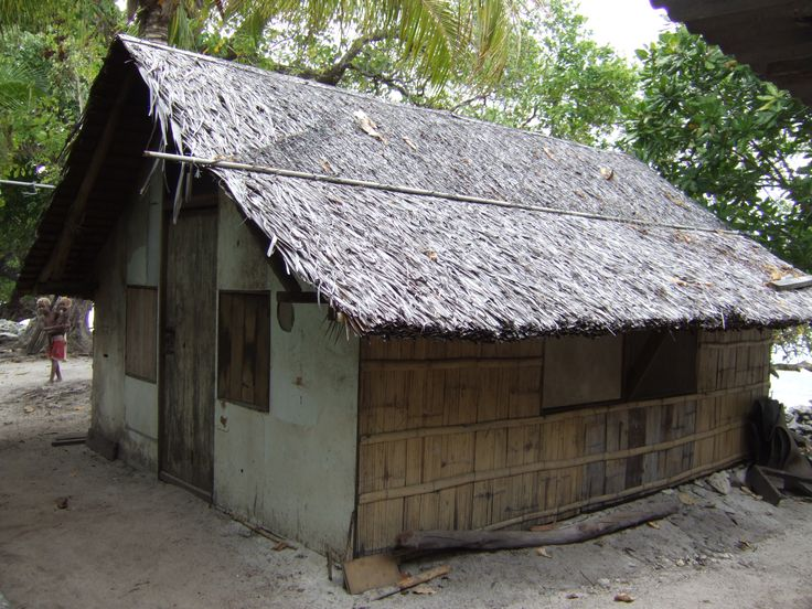 Papua New Guinea vernacular house. Sago leaf roof, bamboo walls, shutters instead of windows for cross ventilation and light, but keeps out the sun for cooler indoor temperatures. Everything breathes. Used mainly for sleeping and storage as the Papua New Guineans live outside mainly.