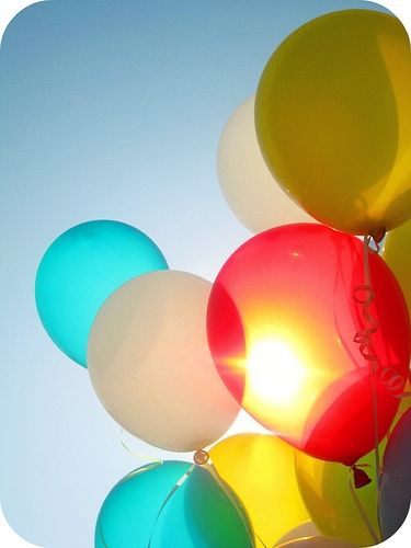 put a piece of paper with a note on it in a balloon. blow the balloon up. let it go and someone will get it.