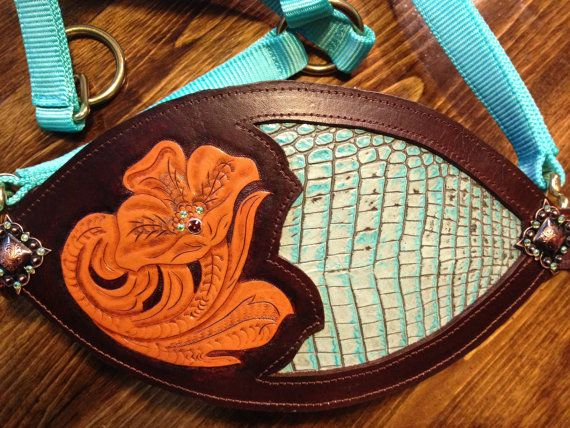 Hand tooled leather bronc horse halter. Halter has copper conchos and Swarovski crystals.