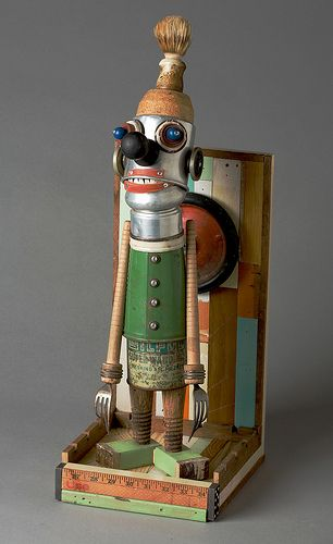 Anthony Pack, Urban Folk Art. Overland Park, Kansas. With basic woodworking skills and found objects, he creates whimsical character sculptures.