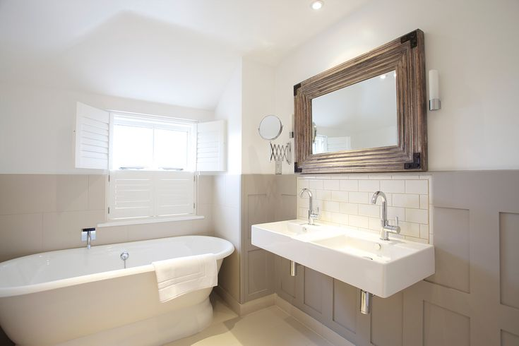 pale neutral bathroom with free standing tub - thetidehouse.co.uk boutique hotel in Cornwall England