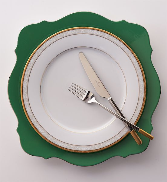 Wedgwood green plate, Noritake gold-rimmed plate, Villeroy and Boch cutlery