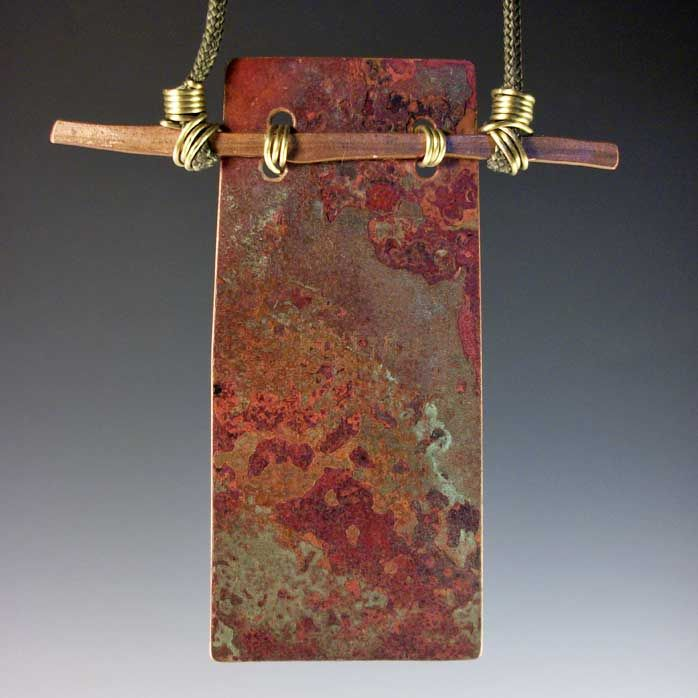 A long standing favorite. This light weight copper pendant is always striking and artful. With GREAT colors, textures, and patinas that, as always, are naturally part of the old roof flashing or copper gutters I hunt for all over my Island of Maui. Smashed copper electrical wire is the cross bar and the whole thing is fully adjustable and great fun. Varies, but never much longer than 2.5 inches long.