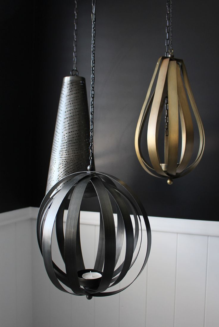 Bungalow Renovation. Hanging lanterns above the bath from SM Interiors. Interior by Lou Brown Design.