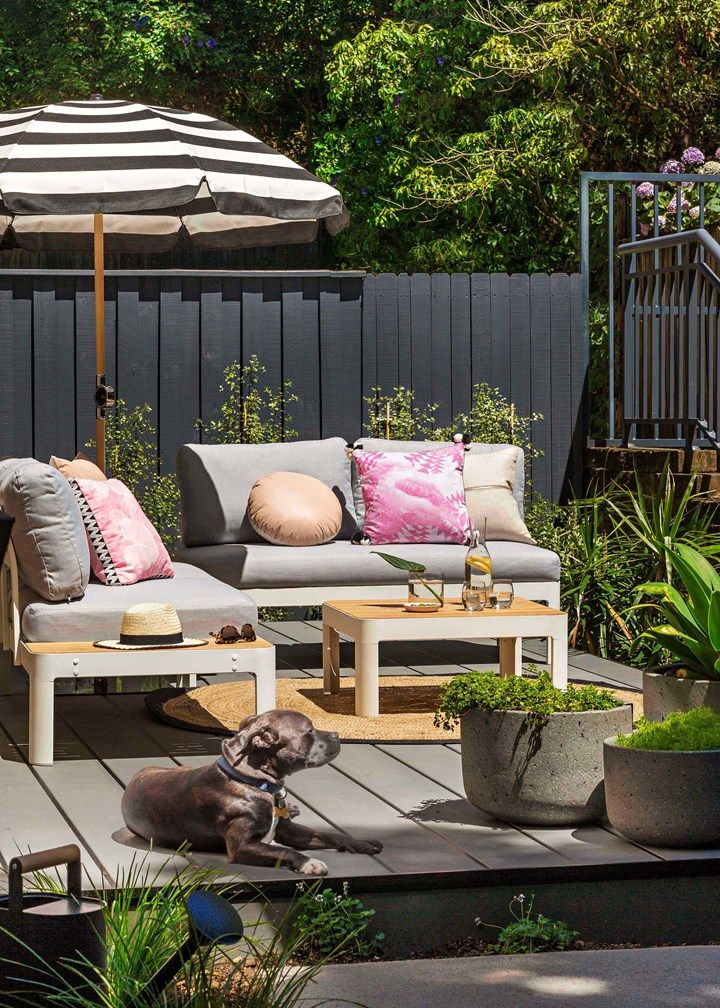 Outdoor transformation | The new Hardiedeck, given two coats of Berger 'Jet Dry Non Slip Flat' in Colorbond Basalt, has transformed the entertaining area.