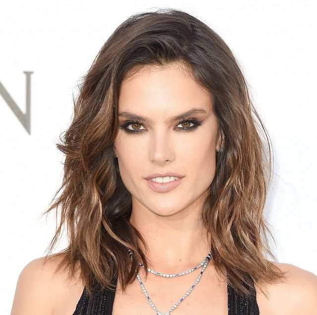 Alessandra Ambrosio's sultry eye makeup and soft, sun-kissed brown waves are the perfect summer beauty look
