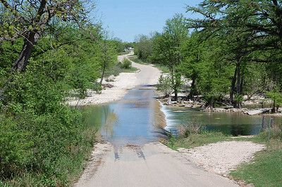 Frio River, Texas; They built the road system going through the river.  Love it!