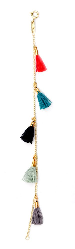 Tassel Bracelet. This isn't a tutorial, but I have instructions on how to make tassels pinned on this board, and here's some good inspiration for what to do with them! I'd wear this.