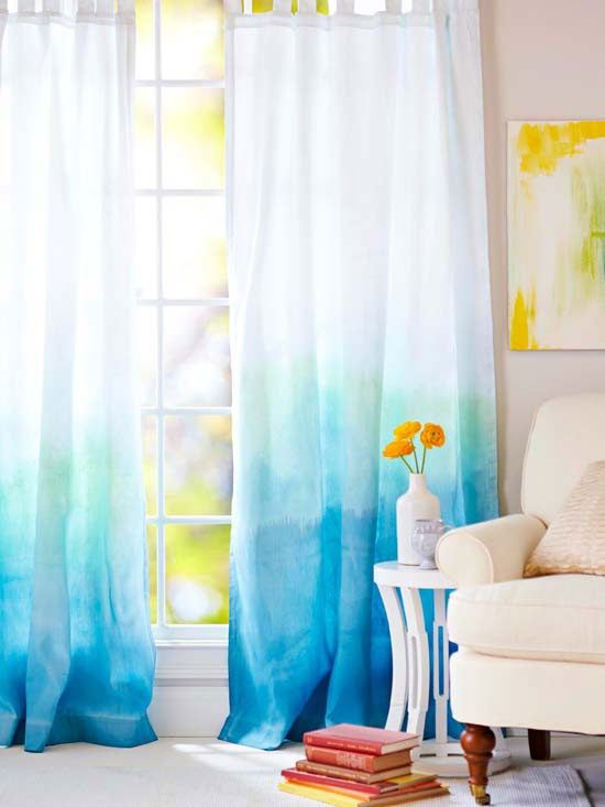 Ombre Drapes - Add waves of color to plain white panels by progressively dyeing with two colors of acrylic crafts paint. We paired deep blue and teal. Dip the damp fabric into a solution of 1 tablespoon crafts paint per gallon of water. Add more paint to the mixture and dip the lower portions of the curtain repeatedly to achieve an intense color.  How to Tub-Dye