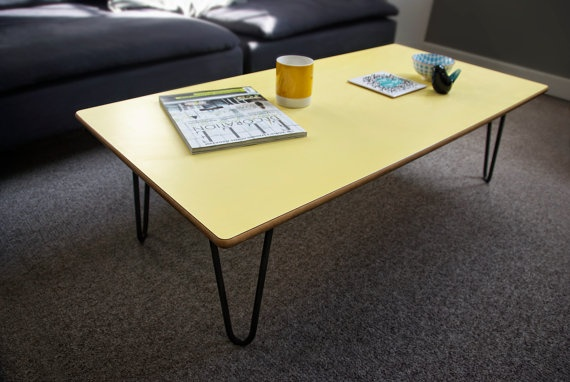 A BEAUTIFUL UNIQUE LEMON,FORMICA TOPPED COFFEE TABLE WITH HAIRPIN LEGS. THE TOP WAS RECYCLED FROM AN OLD SCHOOL DESK WITH RECLAIMED HAIRPIN LEGS.