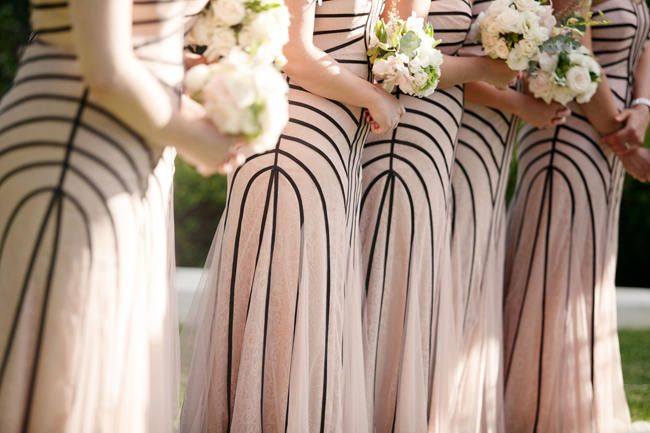 Love these unique blush and gray striped bridesmaid dresses! (Moira West Photography)