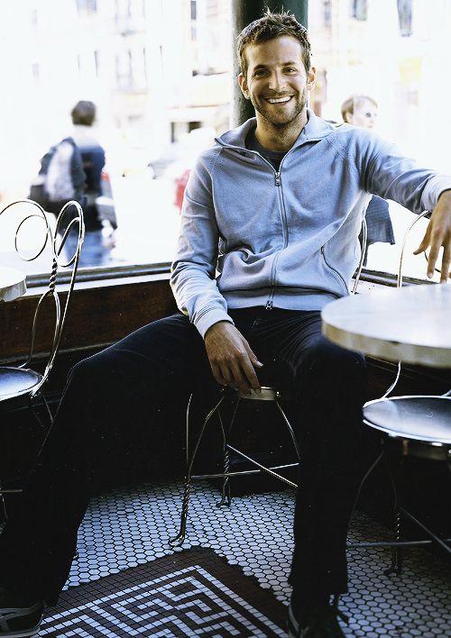 Bradley Cooper in a grey jacket and dark denim. Effortless style for men.