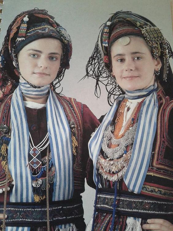 "Vlachs Prosotsanis Dramas - historical #Macedonia, #Greece. This costume, the katsoula, (a triangular hat) is filled with hair to stand upright and fastened with a beaded chinstrap, the ""mangouri"". The braids are wound over the cap and are fastened with two beaded pins. Over the top is wrapped the ""blask"", the Vlach scarf that is fastened with beaded hairpins. From the collection of the Greek Lyceum - Athens"