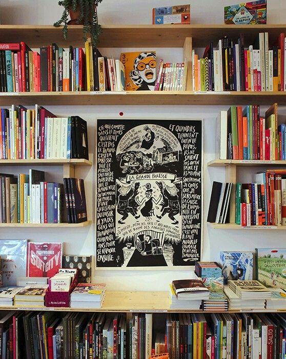 Floating bookshelves arranged around art