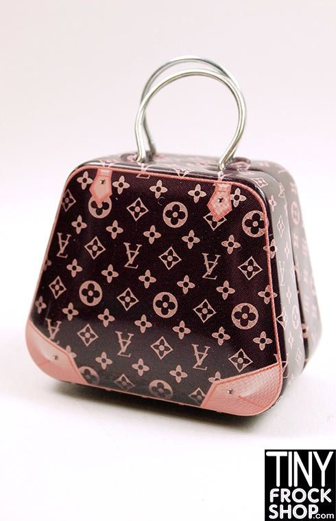 Oh how we covet Louis Vuitton! Now you can get a LV style bag for Barbie! This large sized bag is printed metal with metal ring straps. Opens with a pressure hinge to fit all of your lovely items insi