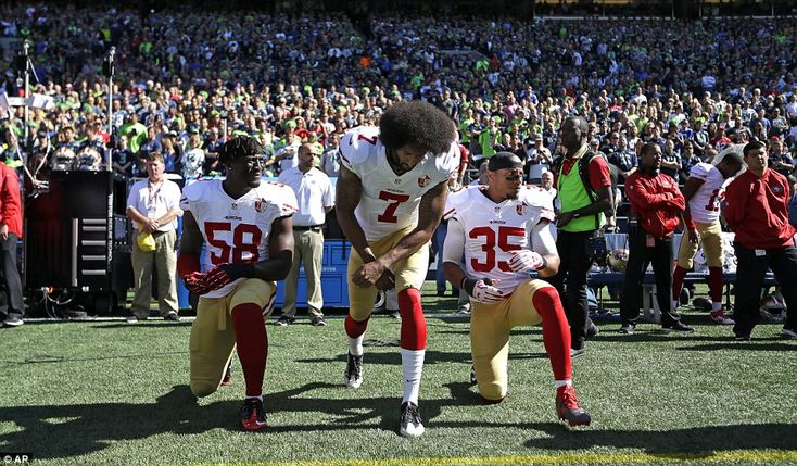 More than 40 NFL players across the league have taken part in ongoing protests against racial injustice - includingEli Harold (left), Colin Kaepernick (middle) and Eric Reid (right) of the San Francisco 49ers