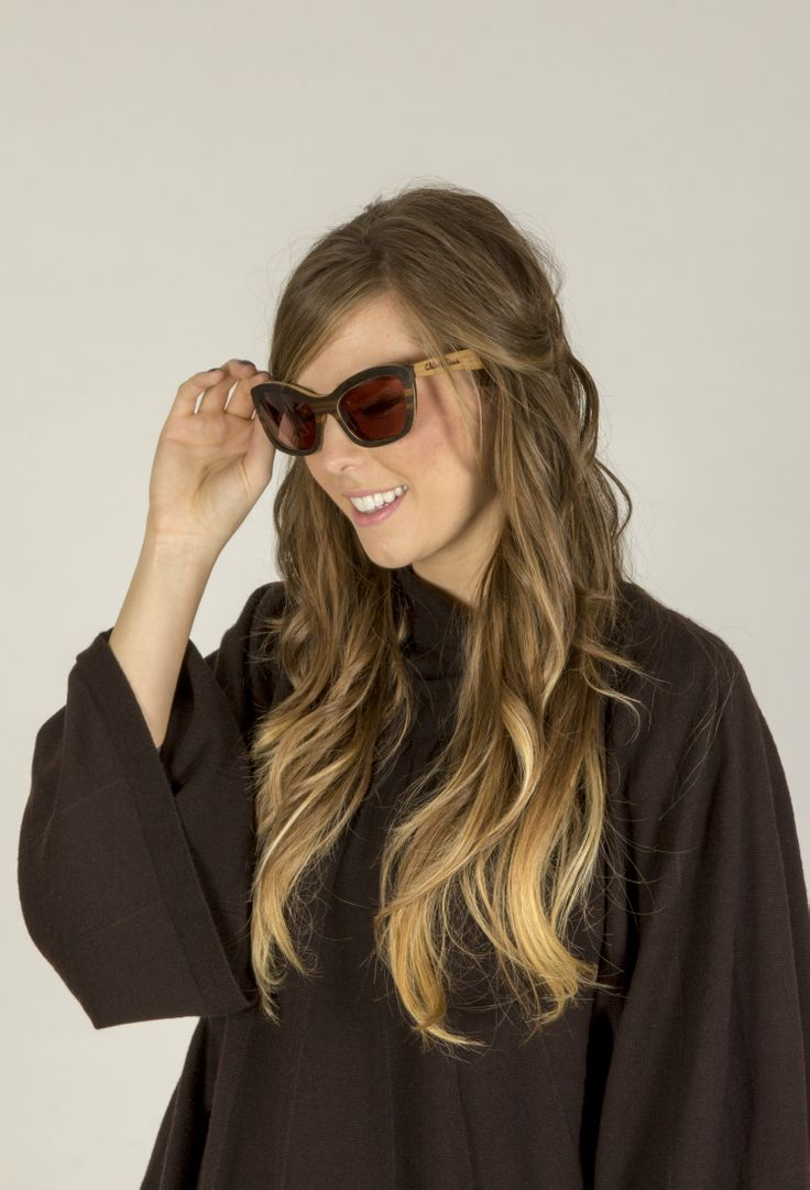 Kosy cape in Espresso worn with Cleopatra style glasses the perfect outfit to take you into spring. www.johnsmedley.com
