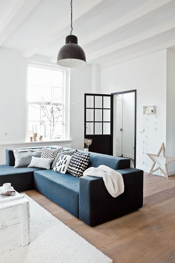 Living Room: White walls+Blue Couch+Blue Art with Black Trim+Dark Floors
