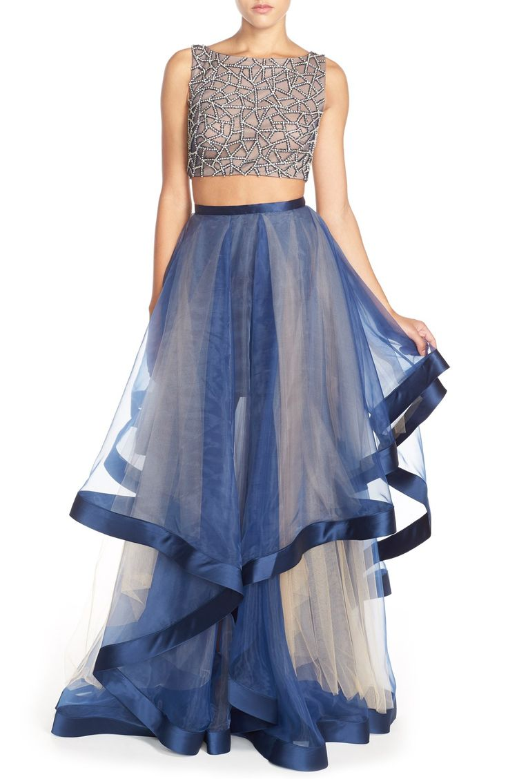 On trend: two-piece ballgowns. This one from Terani Couture pairs an intricately beaded top with a full, organza skirt.
