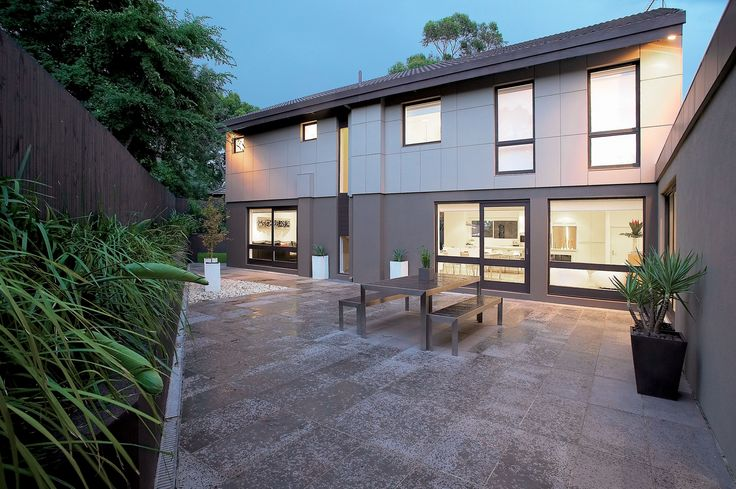 Design Danni Brown | Sundowner Court | Rear Garden | Bluestone | Lomandra | Black Fence